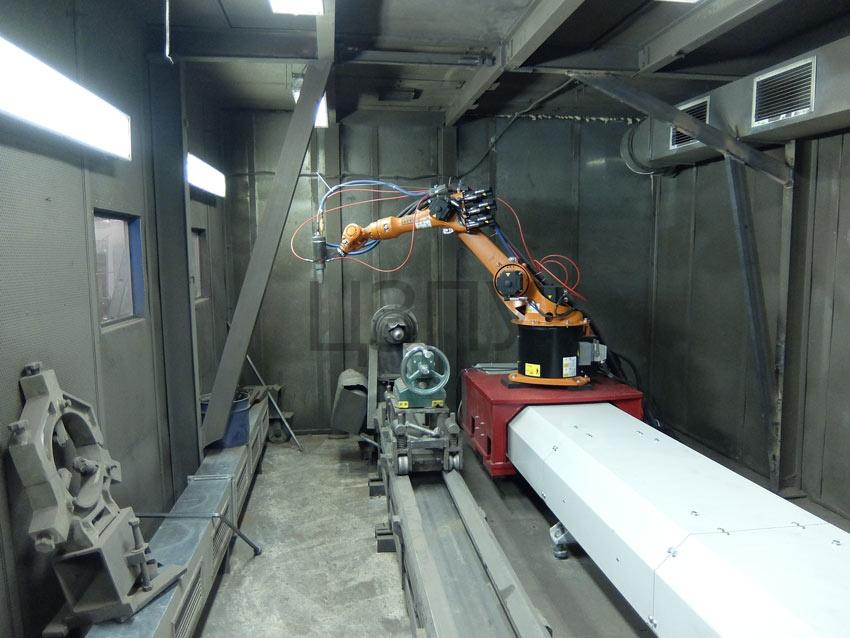 напыление металла роботом